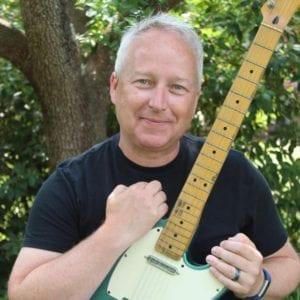 Chris Butler with Guitar