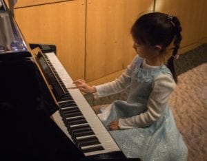 Kid Playing Piano at Recital