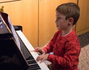 Kid Playing Piano at recital